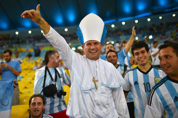 An Argentina's soccer fan dressed like pope Francis cheers at the Maracana Stadium in Rio de Janeiro, on June 15, 2014 before