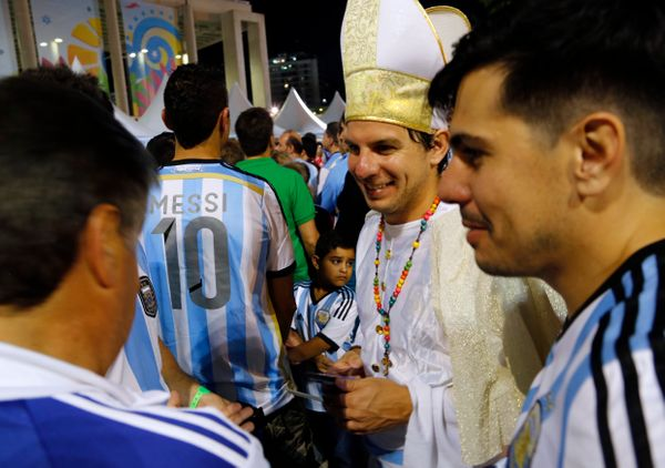 Argentina soccer fans, one dressed as Pope Francis, arrive to Maracana stadium for a World Cup soccer match with Bosnia in Ri