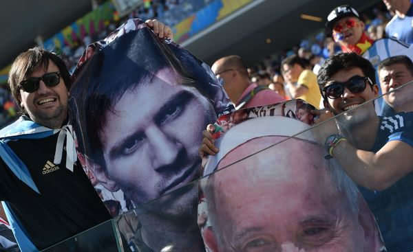 Argentina fans hold up giant portraits of their star footballer Lionel Messi and of Pope Francis prior to a Round of 16 footb