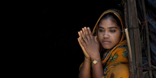 SHAMALAPUR, BANGLADESH - APRIL 11: Rajama sits in the doorway of her home in the Shamalapur Rohingya refugee settlement on Ap