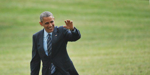US President Barack Obama makes his way across the South Lawn upon return to the White House on July 10, 2014 in Washington,