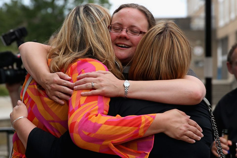 YORK, ENGLAND - JULY 14:  The Revd Dr Hannah Cleugh (C) embraces church members after the Church of England General Synod gav