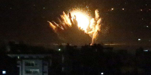 An Israeli missile hits Palestinian buildings in Gaza City on July 17, 2014. Israel launched a ground operation in Gaza late