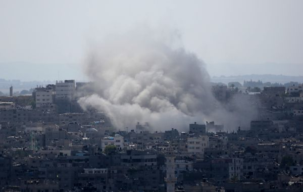 Smoke rises after an Israeli missile strike in Gaza City,  Monday, July 14, 2014.