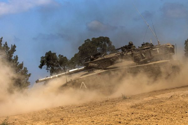 An Israeli Merkava tank rolls at an army deployment along the Israel's border with the Gaza Strip on July 14, 2014.