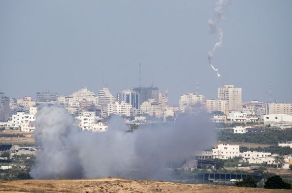 A picture taken on July 14, 2014 from the southern Israeli Gaza border shows an Israeli army flare falling into the Palestini