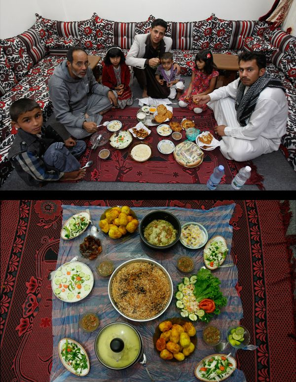 This combination of two photos taken on Wednesday, July 2, 2014, top, and Thursday, July 3, 2014, bottom, shows a Yemeni fami