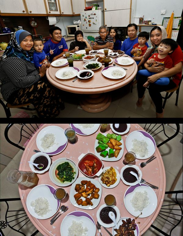 This combination of two photos taken on Thursday, July 11, 2014, shows a Malaysian Muslim family waiting to break their fast,