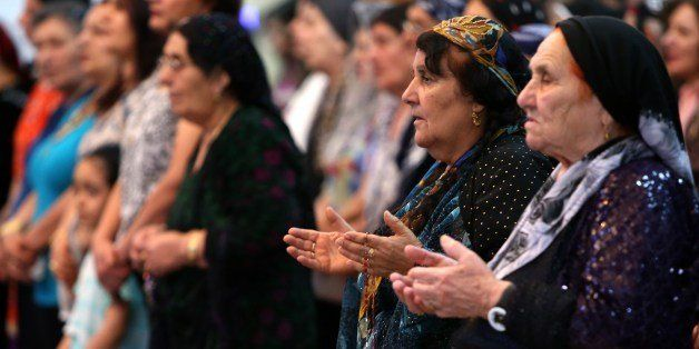 Iraqi Christians pray during a mass at the Saint-Joseph church in Arbil, the capital of the autonomous Kurdish region of nort