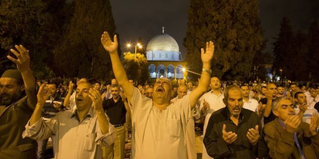 Palestinians hold night prayers in front of the Dome of the Rock at the Al-Aqsa Mosque compound in the Old City of Jerusalem