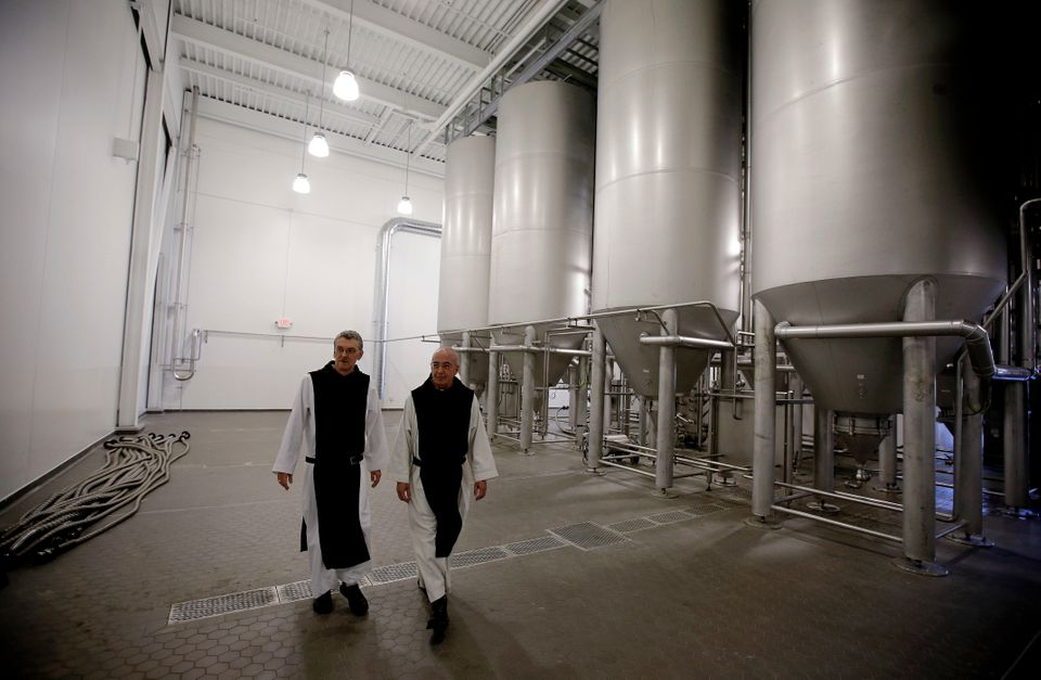 In this Thursday, Jan. 9, 2014 photo, Father Damion, abbot at St. Joseph's Trappist Abbey, left, and Spencer Brewery director
