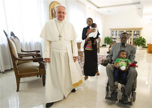 In this photo provided by the Vatican newspaper L'Osservatore Romano, Pope Francis, left, meets in his Santa Marta residence,