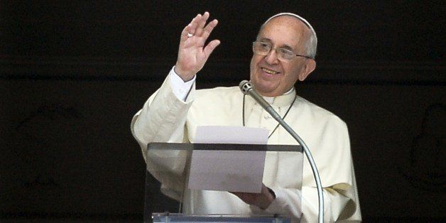 Pope Francis gestures as he delivers a speech from the window of his apartment during his Sunday Angelus prayer in St. Peter'