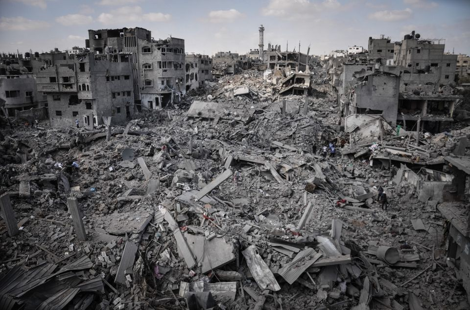 Palestinians inspect their destroyed homes in Shejaiya, Gaza which witnesses said was heavily hit by Israeli shelling and air
