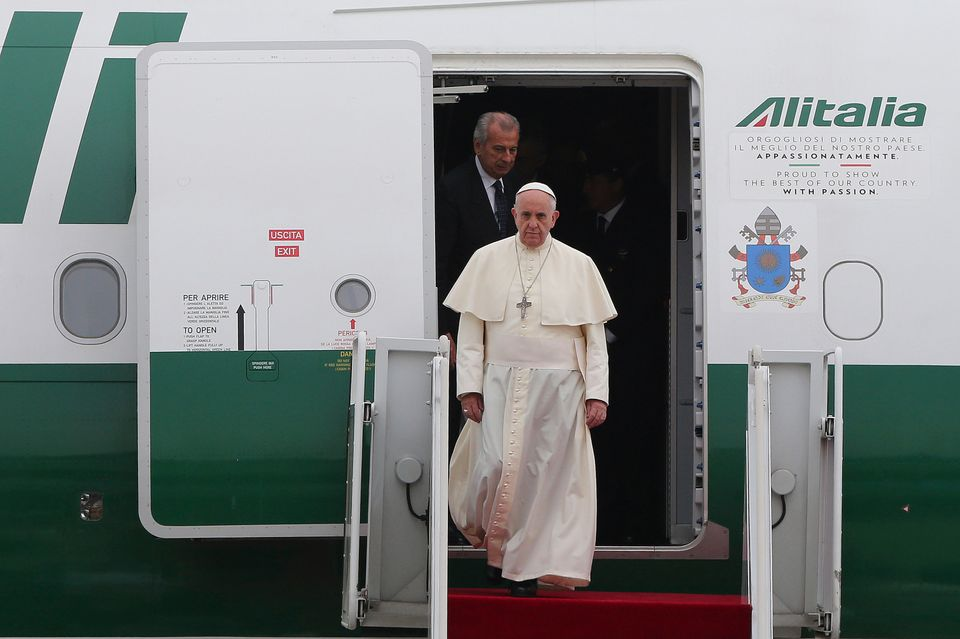Pope Francis steps out from his plane upon his arrival at Seoul Air Base in Seongnam, South Korea, Thursday, Aug. 14, 2014. P