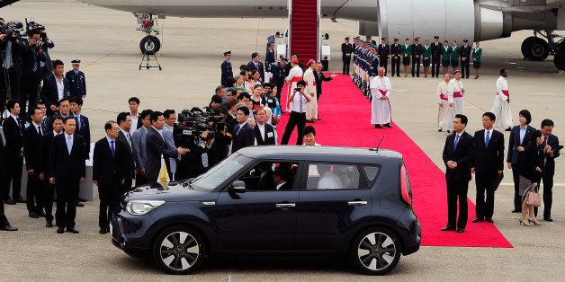 SEOUL, SOUTH KOREA - AUGUST 14:  Pope Francis (inside a car) arrives at Seoul military airport on August 14, 2014 in Seoul, S