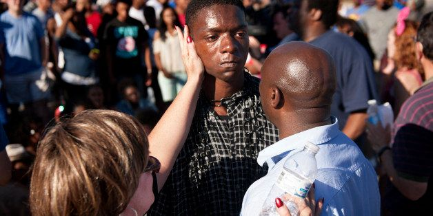 FERGUSON, MISSOURI - August 13, 2014: The Rev. Willis Johnson (right) confronts 18-year-old Joshua Wilson as protesters defy