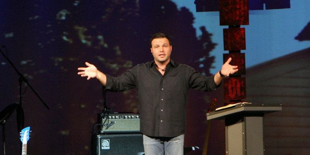 ** ADVANCE FOR FEB. 17-18 WEEKEND EDITIONS ** Mars Hill Church Lead Pastor Mark Driscoll, 36, preaches during an evening serv