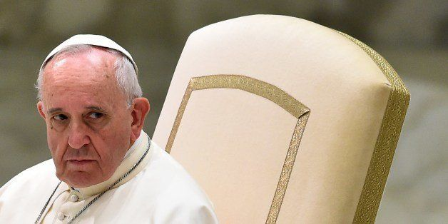 Pope Francis attends his general audience in the Paul VI hall at the Vatican on August 20, 2014. AFP PHOTO / GABRIEL BOUYS