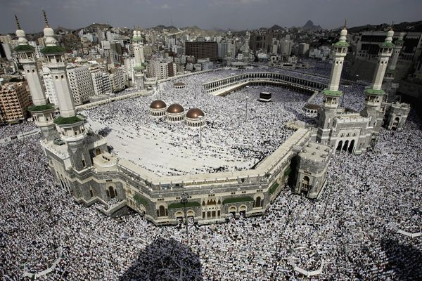 <strong>Muslim pilgrims pray around the holist Al-Ka'aba mosque Jan. 14, 2005, in Mecca.</strong>
