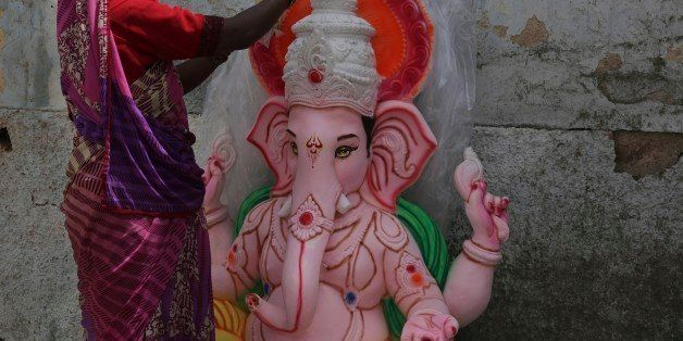 An Indian artist paints an idol of elephant-headed Hindu god Ganesha ahead of the Ganesh Chaturthi festival in Hyderabad, Ind