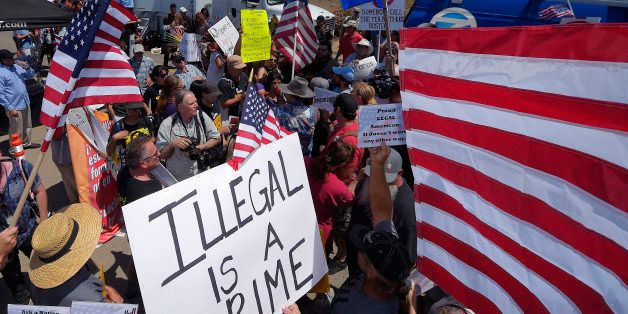 Demonstrators confront each other, Friday, July 4, 2014, outside a U.S. Border Patrol station in Murrieta, Calif. Demonstrato