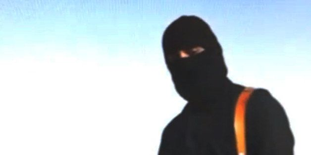 This still image from an undated video released by Islamic State militants on Tuesday, Aug. 19, 2014, purports to show journa