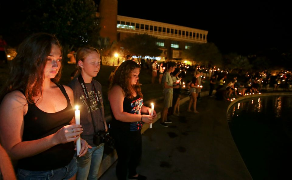 Students and supporters take part in a candle light vigil at the University of Central Florida, Wednesday, Sept. 3, 2014, in