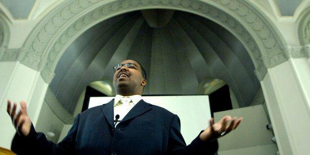 DENVER, COLORADO--FEBRUARY 28, 2007-ABOVE: Ephren Taylor  addresses a lunchtime audience at St. Cajetan's Church on the Aurar