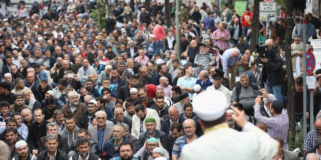 BERLIN, GERMANY - SEPTEMBER 19:  Muslims gather for Friday prayers on the street outside the Mevlana Moschee mosque on a nati