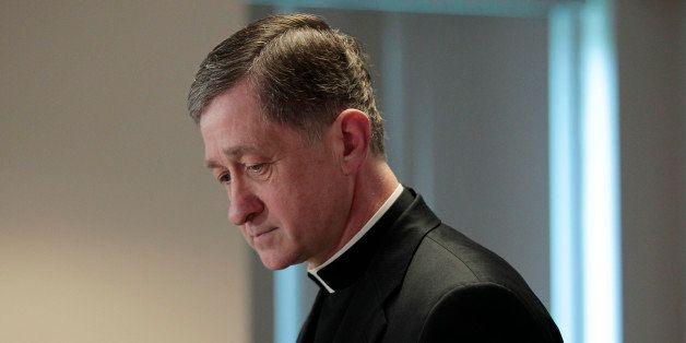 Bishop Blase Cupich of Spokane Wash., walks away from the podium after making a statement at a news conference by the US Conf