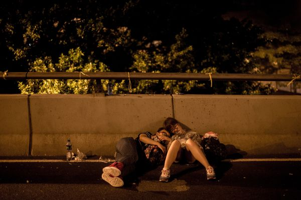 HONG KONG - SEPTEMBER 30:  Protesters sleep on a roadway in the early hours of the morning outside the Hong Kong Government C