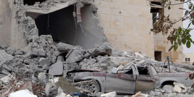 ALEPPO, SYRIA - SEPTEMBER 25:  Rubble of destroyed building and a pickup truck, allegedly belonging to Al-Nusra Front, are se