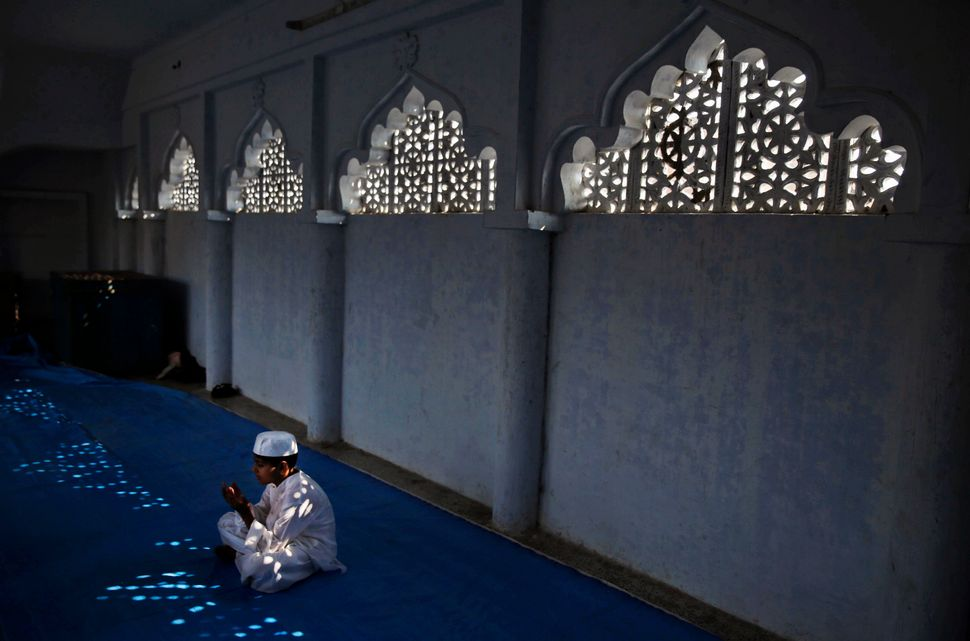An Indian Muslim boy offers prayers during Eid al-Adha inside the Vasi Ullah mosque in Allahabad, India, Monday, Oct. 6, 2014