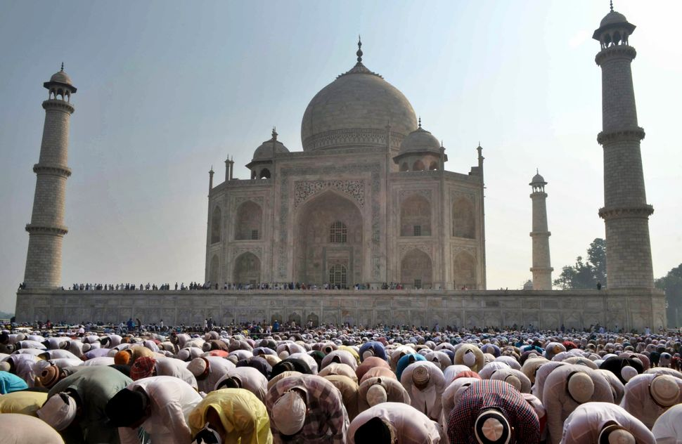 Indian Muslims offer prayers during Eid al-Adha, or the Feast of the Sacrifice, at the Taj Mahal monument in Agra, India, Mon