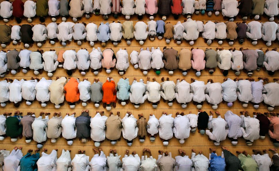 Indian Muslims offer prayers during Eid al-Adha at the Vasi Ullah mosque in Allahabad, India, Monday, Oct. 6, 2014.