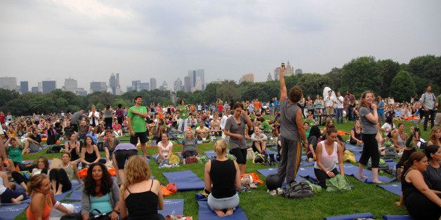 NEW YORK - JUNE 22:  Atmosphere at the in a mass yoga class on the Great Lawn in Central Park on June 22, 2010 in New York Ci