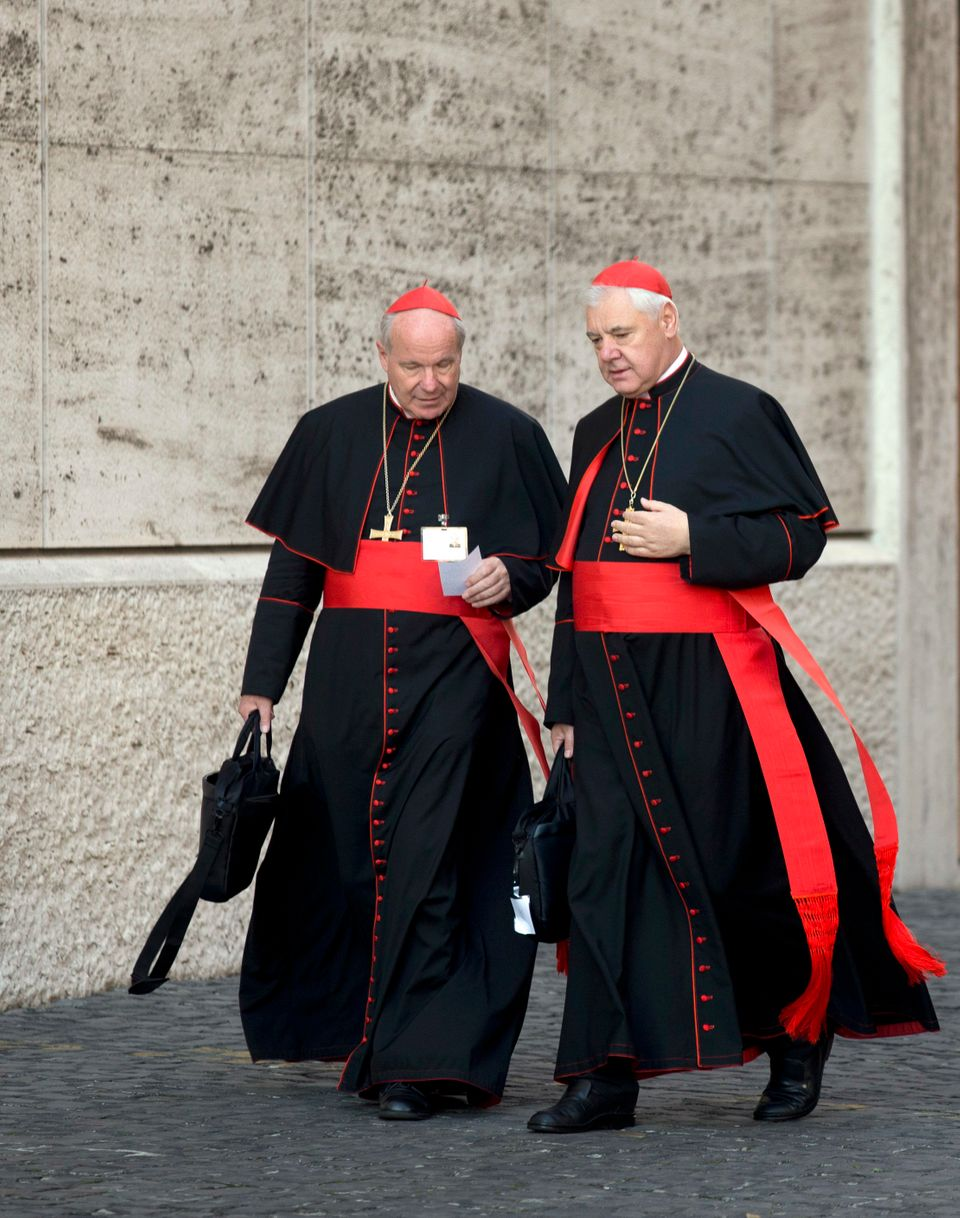 Austrian Cardinal Christoph Schoenborn, left, and German Cardinal Gerhard Ludwig Mueller, arrive at the morning session of th