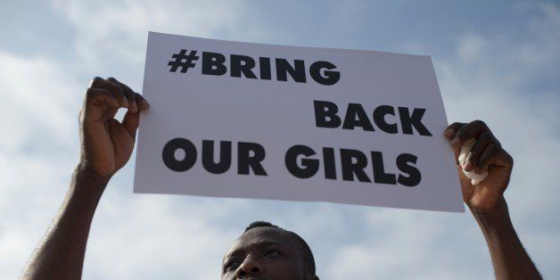 A man holds a placard reading 'Bring Back Our Girls' to denounce the kidnapping of more than 200 Nigerian schoolgirls by Isla
