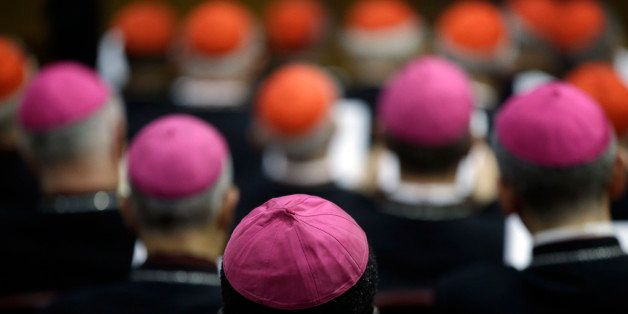 Bishops and Cardinals attend a morning session of a two-week synod on family issues at the Vatican, Monday, Oct. 13, 2014. (A