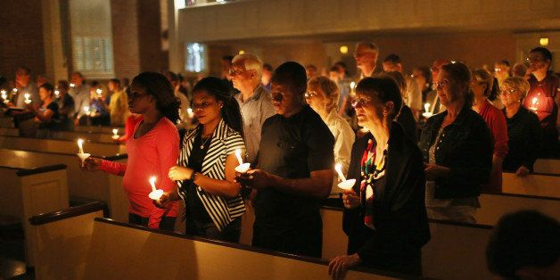 DALLAS, TX - OCTOBER 08:  People hold candles during a  a prayer vigil and memorial at Wilshire Baptist Church for Thomas Eri