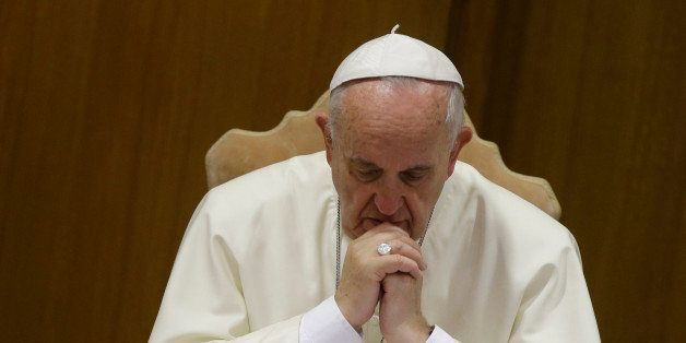 Pope Francis prays as he opens the morning session of a two-week synod on family issues at the Vatican, Saturday, Oct. 18, 20