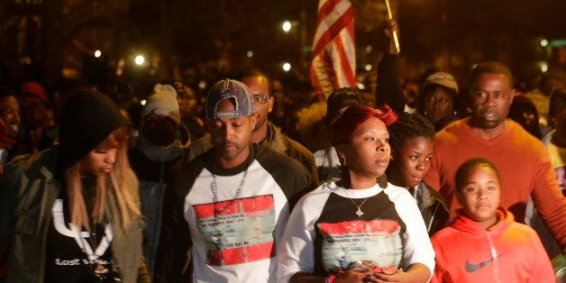 Lesley McSpadden, center, mother of Michael Brown, marches in a protest in Ferguson, Mo. on Saturday, Oct. 11, 2014. On Aug.