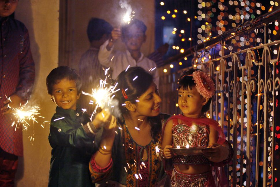 A family enjoy sparklers on the eve of Diwali on Oct. 22, 2014 in New Delhi, India.