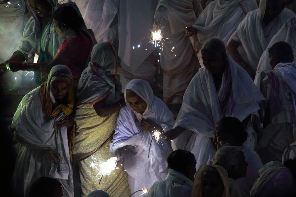 Hundreds of widows celebrate Diwali at the banks of the Yamuna river in Vrindavan, India on Oct. 21., 2014.