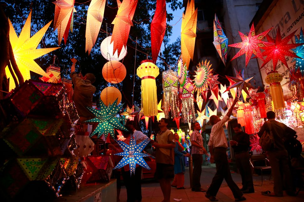 Indians buy lanterns and lamps from roadside stalls ahead of Diwali in Mumbai, India, Monday, Oct. 20, 2014.