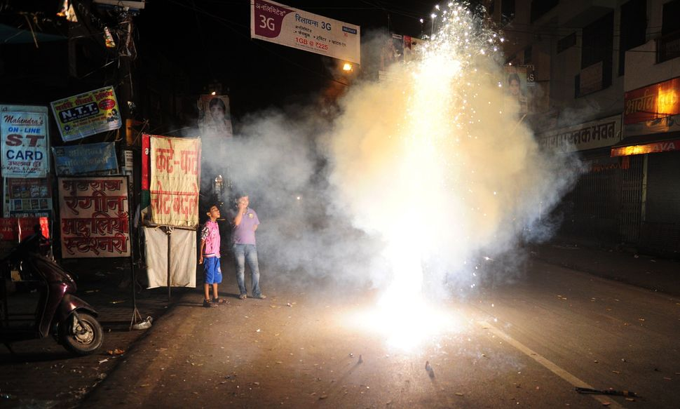 Indian children light fireworks as they celebrate Diwali in Allahabad, India, on October 23, 2014.
