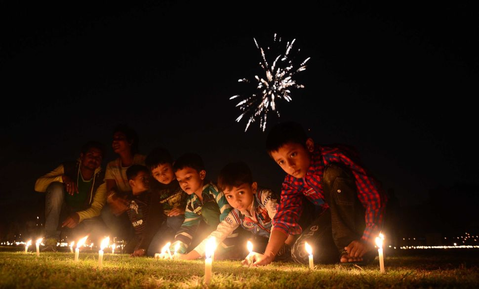Children in Allahabad, India, light candles at the Madan Mohan Malviya Stadium on Oct. 22, 2014, in celebration of Diwali.