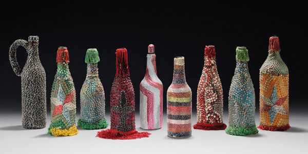 Sequin-covered bottles are some of the most common objects used in Vodou rituals. Each bottle has the colors associated with