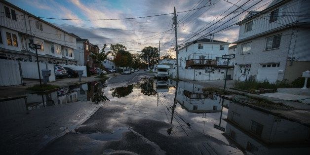 NEW YORK, UNITED STATES - OCTOBER 24: A view of puddle on a street of Staten Island that experienced severe damage and loss o